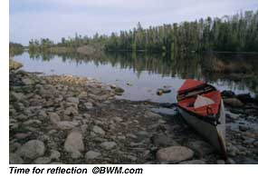 [PHOTO: A canoe sitting on the shore of a beautiful, tranquil lake... time for reflection.